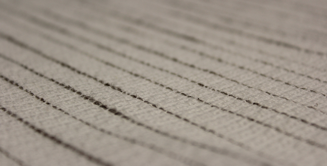 White fabric with black lines